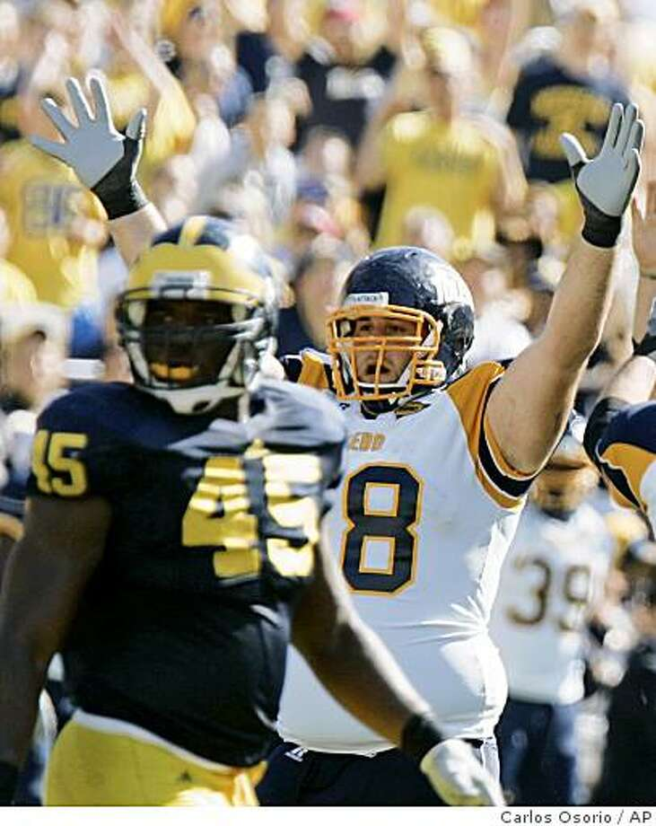 Toledo lineman Jared DeWalt (68) and Michigan linebacker Obi Ezeh (45) watch as Toledo kicker Alex Steigerwald's field goal clears the goal posts during the fourth quarter of an NCAA college football game in Ann Arbor, Mich., Saturday, Oct. 11, 2008. Toledo defeated Michigan 13-10. (AP Photo/Carlos Osorio) Photo: Carlos Osorio, AP