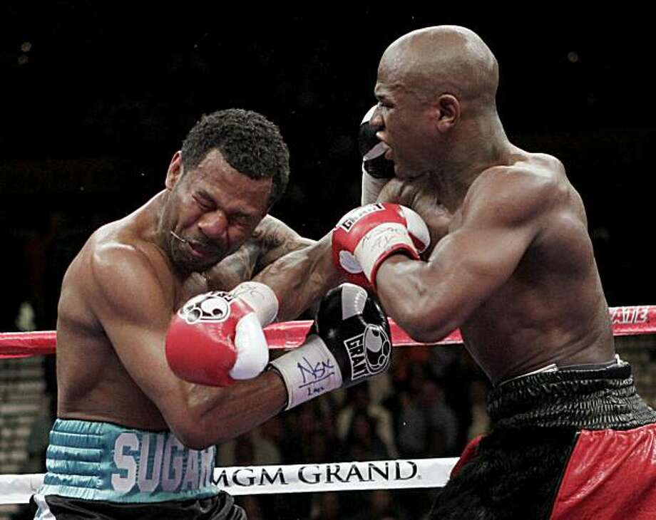 Floyd Mayweather Jr., right, lands a punch against Shane Mosley, during their WBA welterweight boxing match Saturday, May 1, 2010, in Las Vegas. Photo: Jae C. Hong, AP