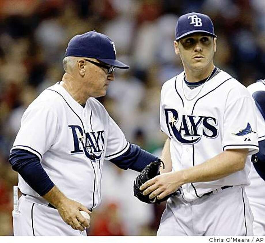 Tampa Bay Rays pitcher Scott Kazmir, right, is removed from the game by manager Joe Maddon in the fifth inning in Game 2 of the American League championship series in St. Petersburg, Fla., Saturday, Oct. 11, 2008. Kazmir was relieved by Grant Balfour.  (AP Photo/Chris O'Meara) Photo: Chris O'Meara, AP