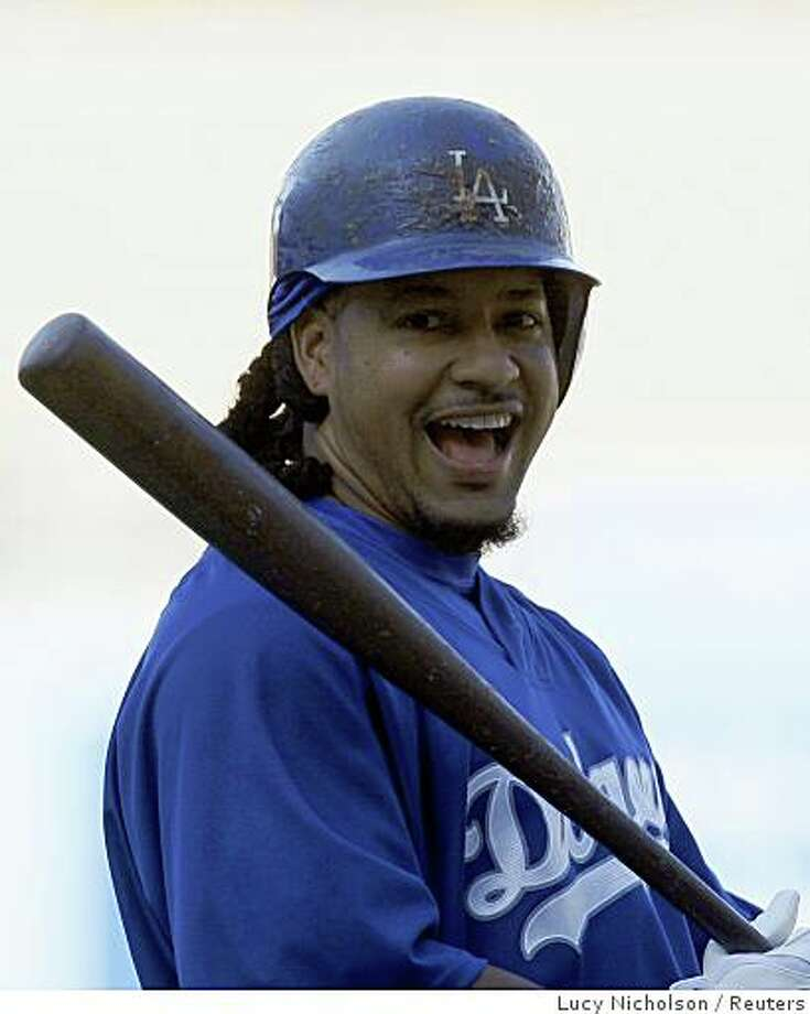 Los Angeles Dodgers outfielder Manny Ramirez prepares to take batting practice for Game 3 of Major League Baseball's NLCS playoff series against the Philadelphia Phillies in Los Angeles, October 11, 2008. Photo: Lucy Nicholson, Reuters