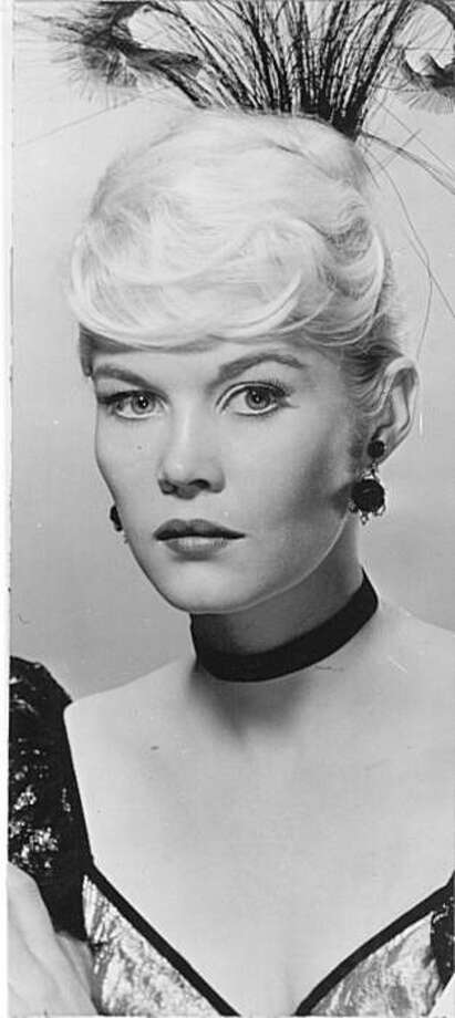 """FILE - Actress Dorothy Provine poses in character for the TV series """"The Roaring Twenties"""" in this July 24, 1959 file photo. Provine, best-known for her roles as Milton Berle's wife and Ethel Merman's daughter in """"It's a Mad, Mad, Mad, Mad World"""" and thehigh-kicking flapper in the 1960s TV series """"The Roaring 20s,"""" has died. She was 75. Provine's husband Robert Day says she died on April 25, 2010 at Silverdale's Hospice of Kitsap County in Washington. Photo: AP"""