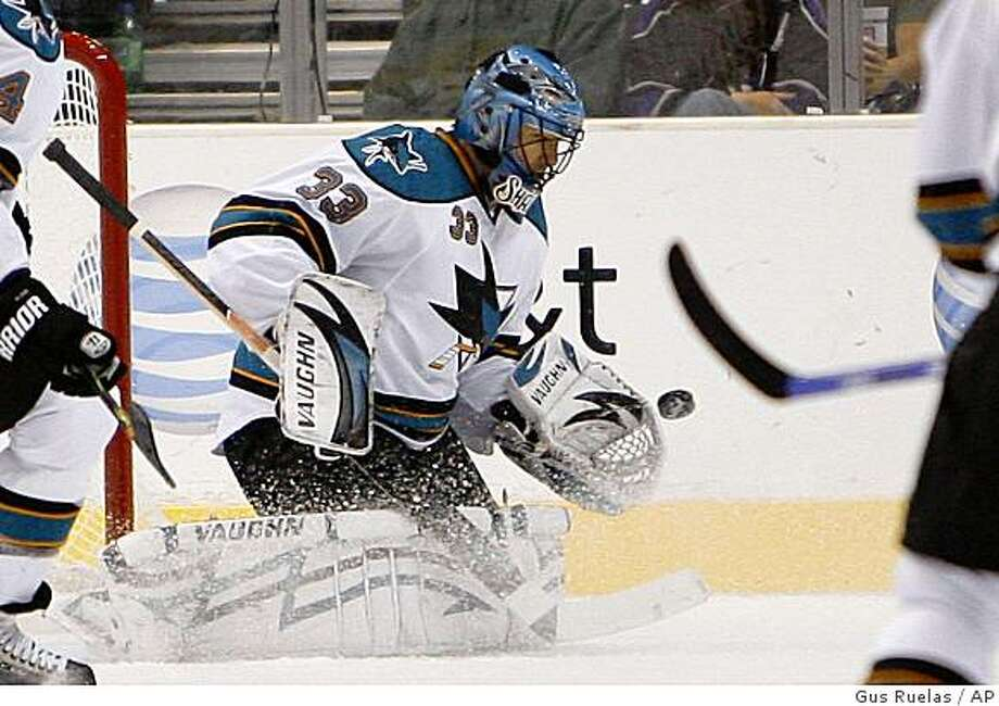 San Jose Sharks goalie Brian Boucher (33) blocks a shot during the first period of their NHL hockey game against the Los Angeles Kings, Sunday, Oct. 12, 2008, in Los Angeles. (AP Photo/Gus Ruelas) Photo: Gus Ruelas, AP