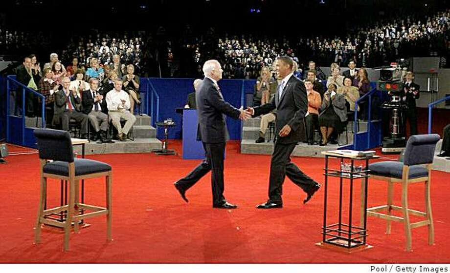 NASHVILLE, TN - OCTOBER 07:  Republican presidential candidate Sen. John McCain (R-AZ) (L) and Democratic presidential candidate Sen. Barack Obama (D-IL)  shake hands during the Town Hall Presidential Debate at Belmont University's Curb Event Center October 7, 2008 in Nashville, Tennessee.   Tonight's debate is the second presidential debate of three, the only one being held in the town hall style with questions coming from audience members.  (Photo by Jim Bourg-Pool/Getty Images) Photo: Pool, Getty Images
