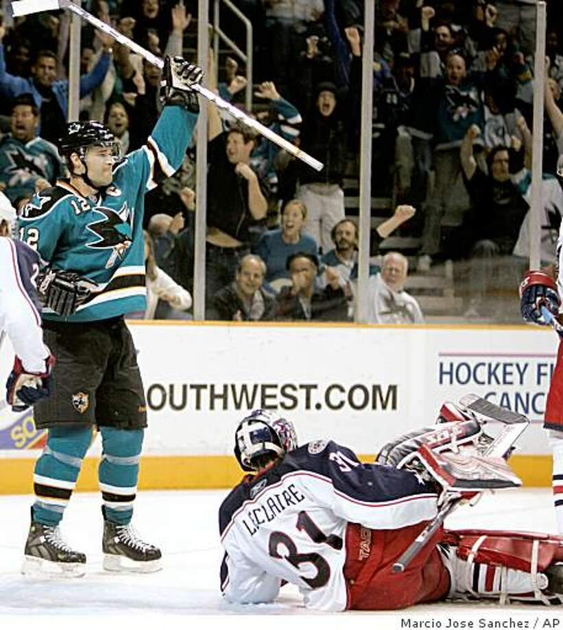 San Jose Sharks center Patrick Marleau, left, celebrates after scoring past Columbus Blue Jackets goalie Pascal Leclaire, right, in the second period of an NHL hockey game in San Jose, Calif., Tuesday, Oct. 14, 2008. (AP Photo/Marcio Jose Sanchez) Photo: Marcio Jose Sanchez, AP