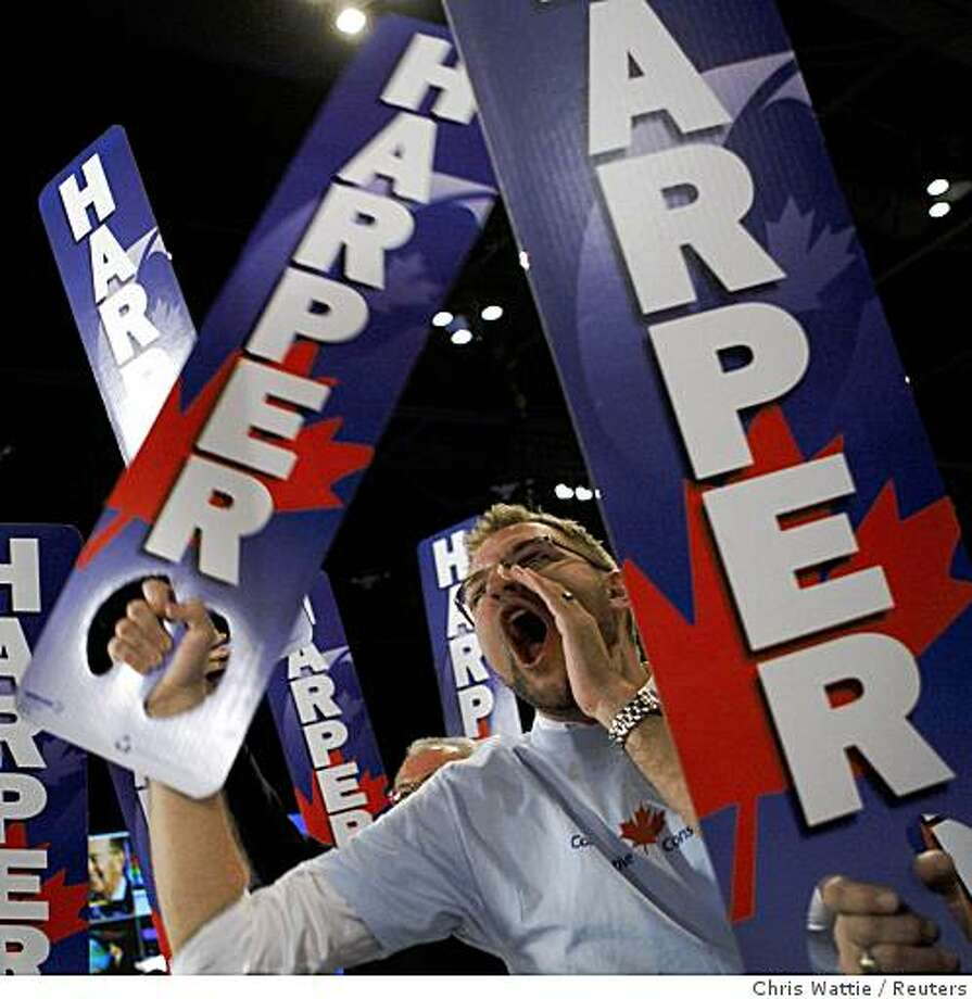 Supporters cheer while they wait for Conservative leader and Canada's Prime Minister Stephen Harper at his election night headquarters in Calgary October 14, 2008.       REUTERS/Chris Wattie       (CANADA) Photo: Chris Wattie, Reuters