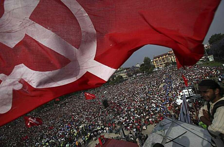 A Communist flag flutters as supporters of Communist Party of Nepal (Maoist) participate in a mass protest rally in Katmandu, Nepal, Saturday, May 1, 2010. Thousands of police in riot gear guarded the streets of Nepal's capital Saturday where former communist rebels plan to bring in half a million supporters to protest against the government. Photo: Altaf Qadri, AP