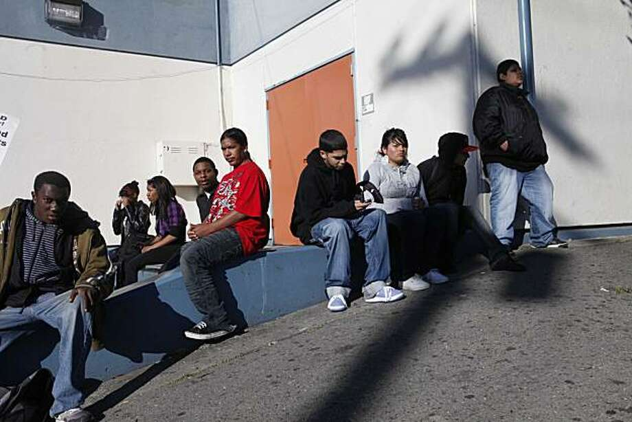 Oakland High School students sit and watch as their teachers picket during a one day strike at all Oakland Unified Schools on Thursday April 29, 2010. The union urged parents to keep their children home for the day in support of the strike but school administrators brought in substitutes in an effort to take care of the students who showed for class. Photo: Mike Kepka, The Chronicle