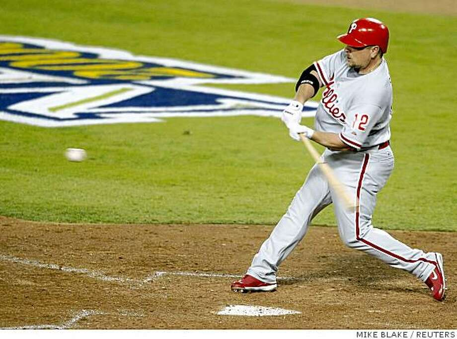 Philadelphia Phillies' Matt Stairs hits a two-run home run against the Los Angeles Dodgers in the eighth inning in Game 4 of Major League Baseball's NLCS playoff series in Los Angeles, October 13, 2008.     REUTERS/Mike Blake (UNITED STATES) Photo: MIKE BLAKE, REUTERS