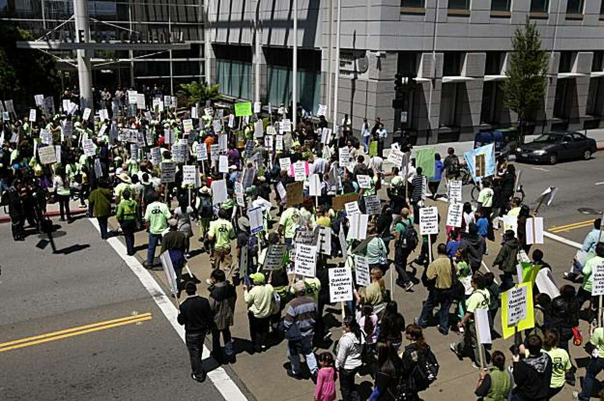 School teachers on a one-day walkout march past the Elihu Harris state office building during a noontime rally in Oakland, Calif., on Thursday, April 29, 2010. School teachers are protesting district-wide cuts in pay and programs.