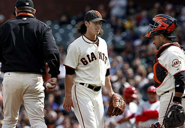 Tim Lincecum walked off the mound after handing the ball to manager Bruce Bochy (left) as catcher Bengie Molina (right) lowered his head in the ninth inning. San Francisco Giants lose to the Philadelphia Phillies 7-6 Wednesday April 28, 2010 in eleven innings at AT&T park. Photo: Brant Ward, The Chronicle