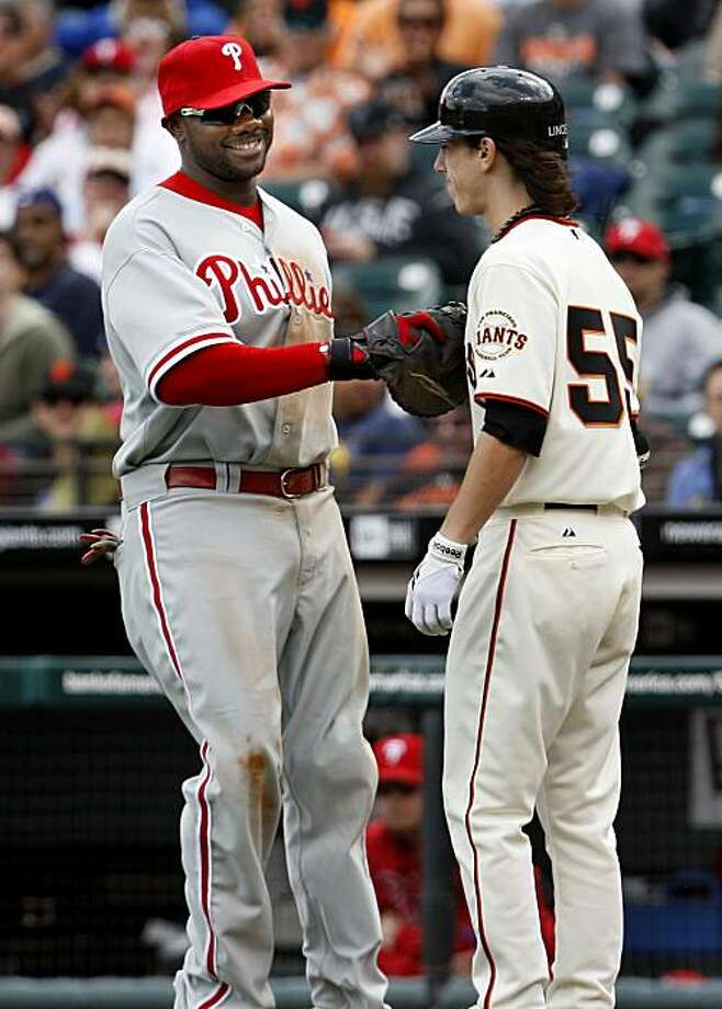 The Phillies Ryan Howard (left) smiled as he tagged out Tim Lincecum after Lincecum sacrifice bunt late in the game. San Francisco Giants lose to the Philadelphia Phillies 7-6 Wednesday April 28, 2010 in eleven innings at AT&T park. Photo: Brant Ward, The Chronicle
