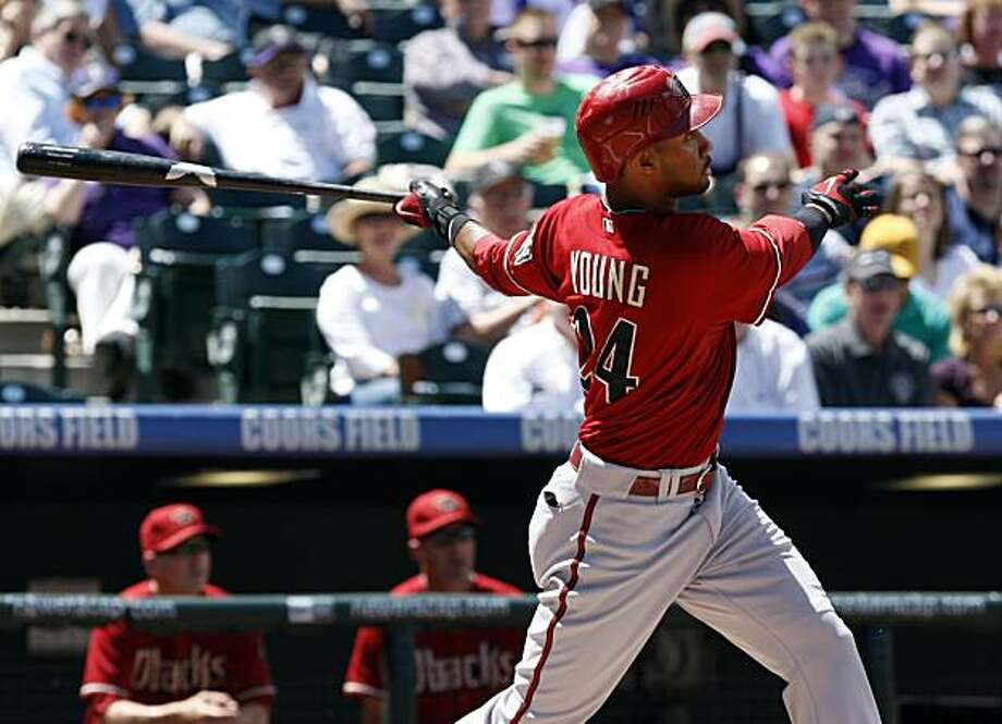 Arizona Diamondbacks' Chris Young follows through on a three-run home run in the first inning of a baseball game against the Colorado Rockies in Denver on Wednesday, April 28, 2010. (AP Photo/Ed Andrieski Photo: Ed Andrieski, AP