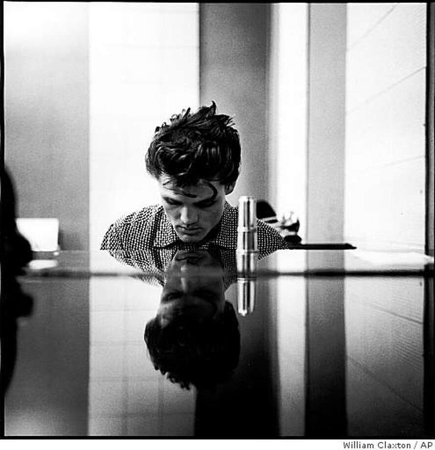 This photo released by Christopher Claxton and taken by William Claxton shows Chet Baker, in the Hollywood section of Los Angeles in 1954. Claxton, a celebrated photographer who worked with such entertainers as Bob Dylan and Frank Sinatra and who helped establish the organization that runs the Grammy Awards, died Saturday Oct. 11, 2008. He was 80. Claxton died of complications stemming from congestive heart failure, his son Christopher said. (AP Photo/Courtesy of Christopher Claxton, �William Claxton) ** NO SALES. NO ARCHIVES. ONE TIME EDITORIAL USE ONLY FOR STORY RELATED TO OBIT. MANDATORY CREDIT  ** Photo: William Claxton, AP