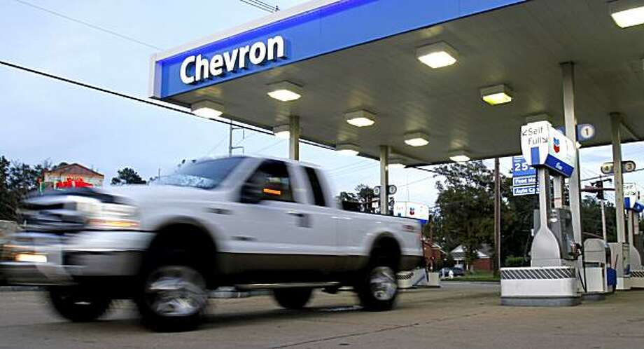 FILE- In this file photo taken, Oct. 29, 2009, a motorist leaves a Chevron gas station in Jackson, Miss. Photo: Rogelio V. Solis, AP