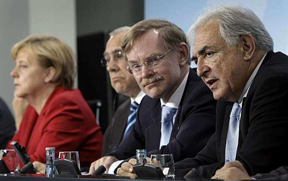 From left, German Chancellor Angela Merkel, Jose Angel Gurria, secretary general of the Organisation for Economic Co-operation and  Development (OECD), Robert Zoellick, President of the World Bank, and Dominique Strauss-Kahn, managing director of the International Monetary Fund address the media after a meeting at the Chancellery in Berlin, Germany, Wednesday, April 28, 2010. Photo: Michael Sohn, AP