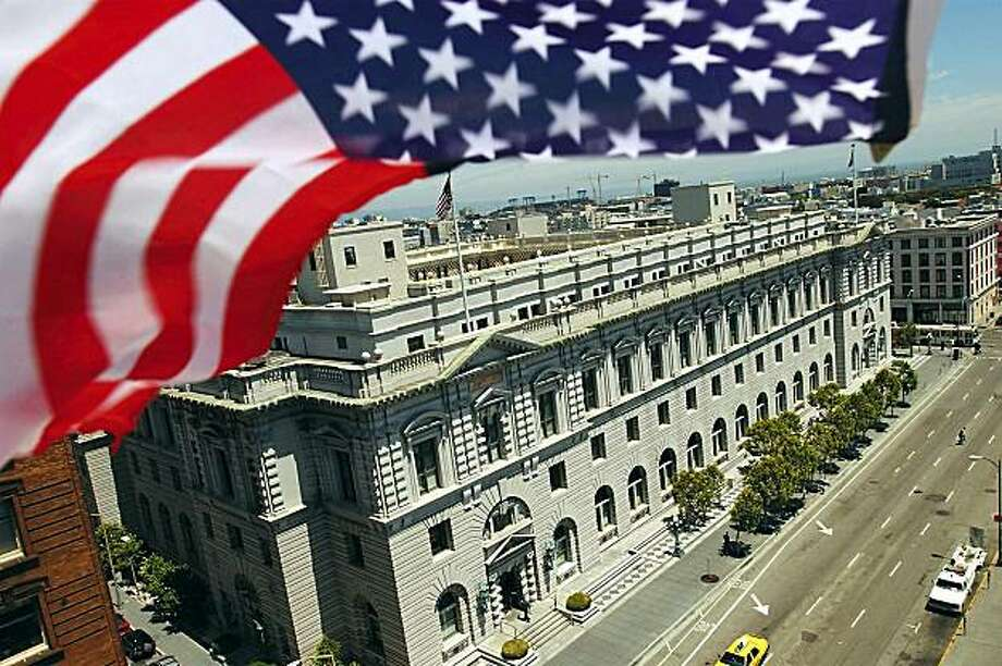 """An American flag waves over the Supreme Court building in San Francisco, Wednesday, June 26, 2002. Stunning politicians on both the left and right, a federal appeals court at the location declared for the first time Wednesday that reciting the Pledge of Allegiance in public schools is unconstitutional because of the words """"under God."""" The ruling, if allowed to stand, would mean schoolchildren could no longer recite the pledge, at least in the nine Western states covered by the court. (AP Photo/David Paul Morris) Photo: David Paul Morris, AP"""