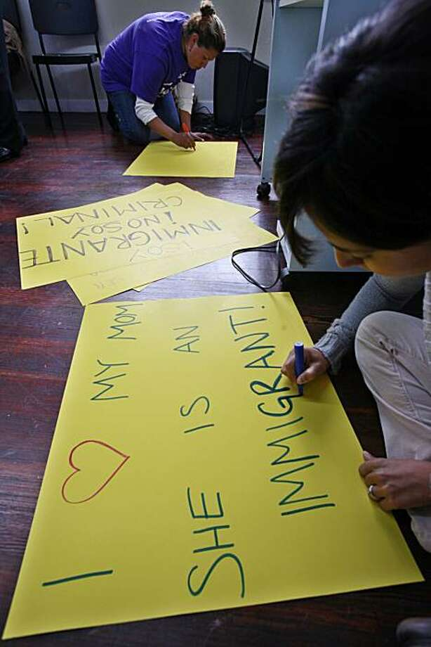 Andrea Mercado makes a sign in Oakland, Calif., Tuesday, April 27, 2010 in preparation for a planned May 1 immigration rally against Arizona Senate Bill 1070. Photo: Paul Sakuma, AP