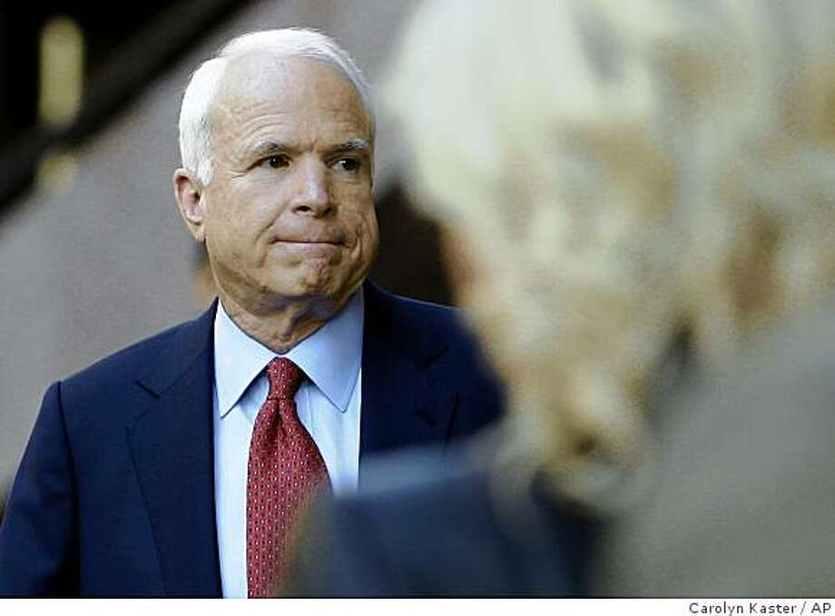 Republican presidential candidate, Sen. John McCain, R-Ariz., pauses as he leaves his campaign headquarters in Arlington, Va. Sunday, Oct. 12, 2008. (AP Photo/Carolyn Kaster) Photo: Carolyn Kaster, AP