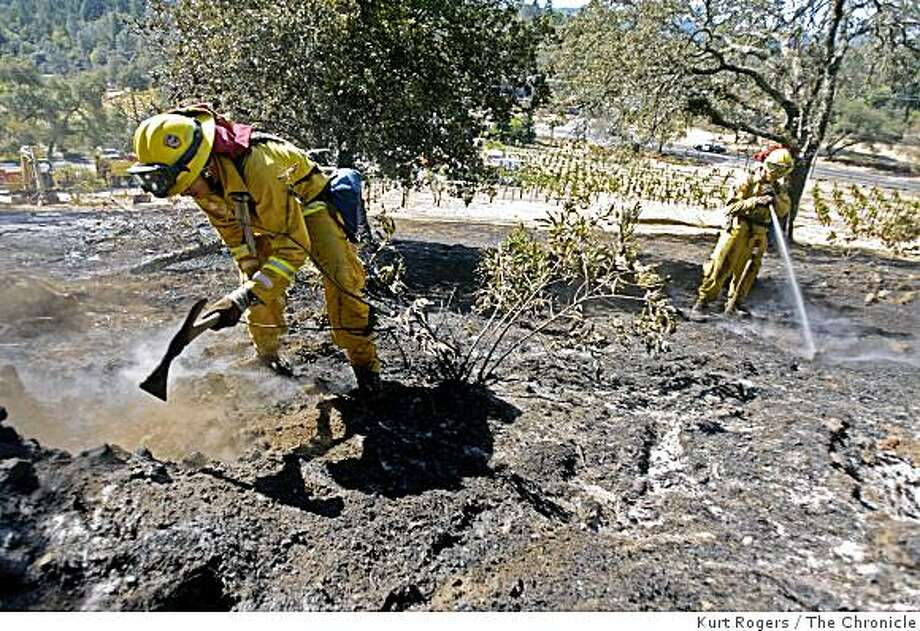 Aneel Khan and Dan Levy a crew from Redbluff CA works on the fire above the Bremer Family Winery off Dear Park and Sanitarium Rd . on Saturday OCT 11,  2008 in ST.Helena , Calif Photo: Kurt Rogers, The Chronicle