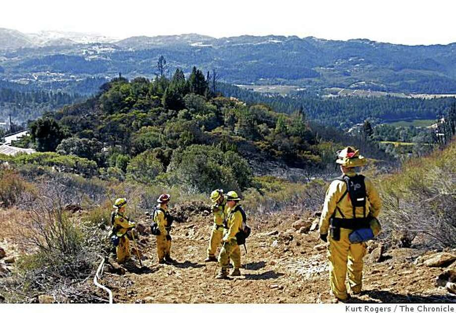 Fire fighters from Sunol and Tracy walk the fire line above the Napa Valley looking for hot spots.  on Saturday OCT 11,  2008 in ST.Helena , Calif Photo: Kurt Rogers, The Chronicle