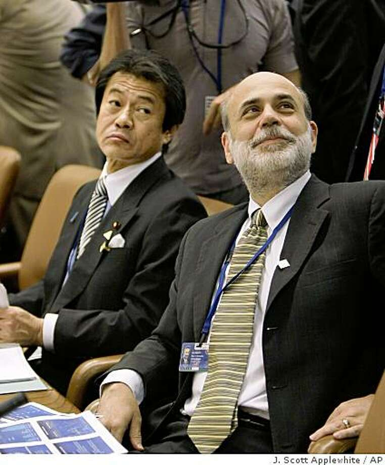 Japan Finance Minister Shoichi Nakagawa, left, and U.S. Federal Reserve Chairman Ben Bernanke, right, take their seats at the International Monetary Fund headquarters for a meeting of the International Monetary and Financial Committee in Washington, Saturday, Oct. 11, 2008.   (AP Photo/J. Scott Applewhite) Photo: J. Scott Applewhite, AP