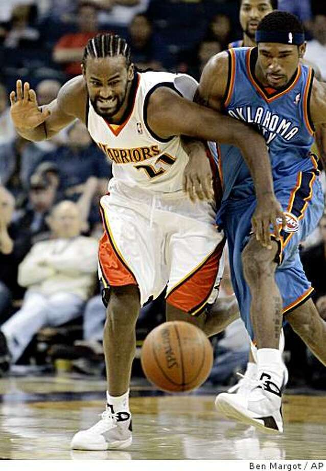 Golden State Warriors' Ronny Turiaf, left, and Oklahoma City Thunder Derrick Byars chase down a loose ball during the first quarter of a preseason NBA basketball game Saturday, Oct. 11, 2008, in Oakland, Calif. (AP Photo/Ben Margot) Photo: Ben Margot, AP