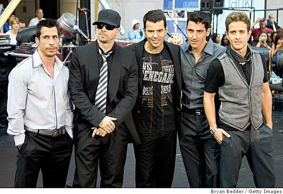 """NEW YORK - SEPTEMBER 04:  (L-R) Singers Danny Wood, Donnie Wahlberg, Jordan Knight, Jonathan Knight and Joey McIntyre of New Kids On The Block perform on NBC's """"Today"""" at Rockefeller Center on September 4, 2008 in New York City.  (Photo by Bryan Bedder/Getty Images) Photo: Getty Images"""