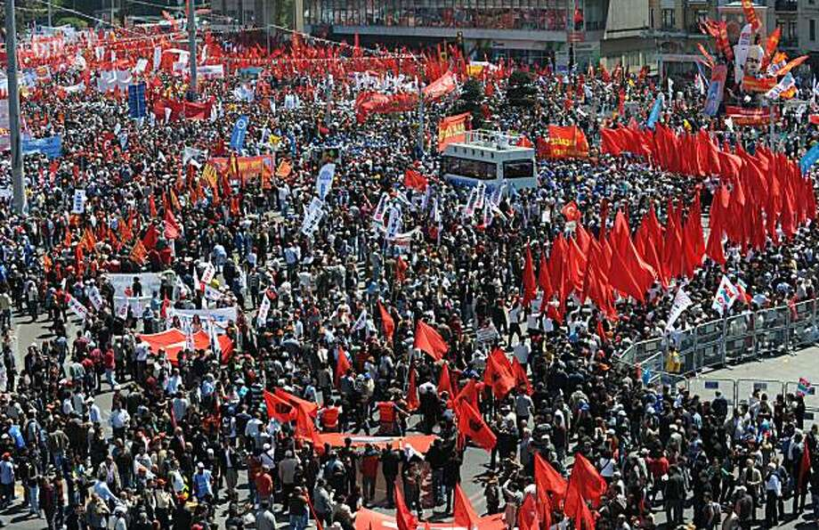 Thousands of workers gather on May 1, 2010 at Taksim square, a symbolic square in Turkey's biggest city Istanbul for the first May Day celebrations at the site after dozens were killed there 33 years ago. Taksim square had been declared off-limits since the bloodshed during a May Day rally there in 1977 when gunmen, believed to be far-right militants aided by members of the intelligence services, fired on a peaceful crowd, triggering mass panic. Photo: Bulent Kilic, AFP/Getty Images