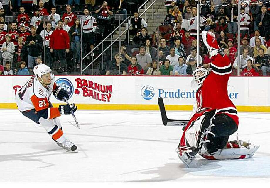 NEWARK, NJ - OCTOBER 10:  Kyle Okposo #21 of the New York Islanders is stopped by Martin Brodeur #30 of the New Jersey Devils on the penalty shot on October 10, 2008 at the Prudential Center in Newark, New Jersey.  (Photo by Bruce Bennett/Getty Images) Photo: Bruce Bennett, Getty Images