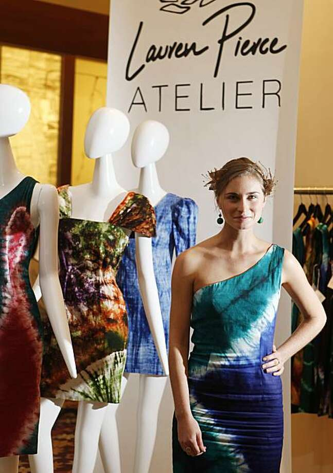 "Clothing designer Lauren Bush stands in front of a new line of dresses she calls ""Lauren Bush Atelier"" at Barney's on Friday March 12, 2010 in San Francisco, Calif.  Customers can pick and choose from custom fabrics made by women in the Congo. Photo: Mike Kepka, The Chronicle"
