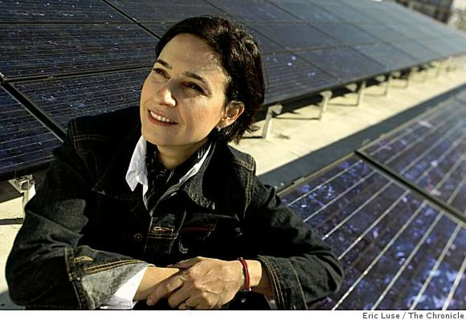 Sylvia Ventura, in front of solar panels on the roof of Open Hand, started 1BOG which helps consumers with solar system decisions. Photo: Eric Luse, The Chronicle