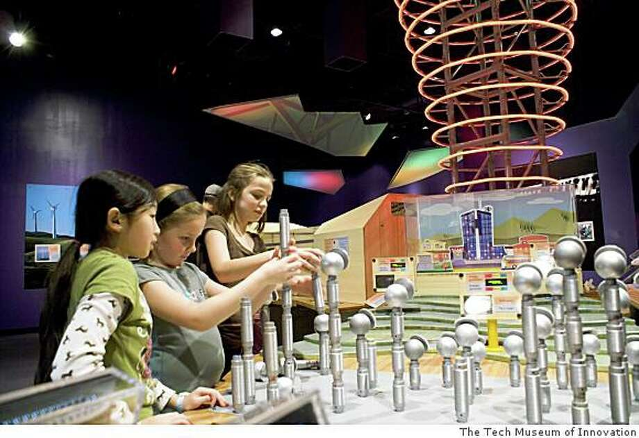 In The Tech�s Green by Design exhibit, an �energy tower� lights up as visitors provide it with energy from hands-on experiments with wind, solar or water power. Photo: The Tech Museum Of Innovation