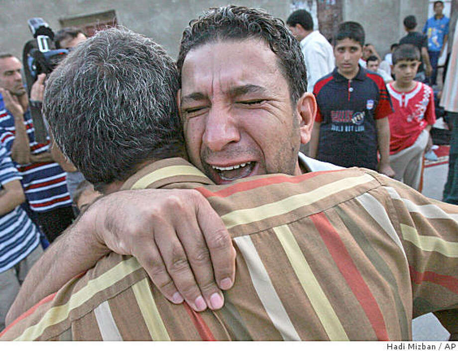 Relatives mourn for Iraqi lawmaker Saleh al-Auqaeili , loyal to anti-U.S. Shiite cleric Muqtada al-Sadr,  outside his home in Baghdad, Iraq, Thursday, Oct. 9, 2008. Officials say Thursday's explosion occurred as Saleh al-Auqaeili's car passed about 200 yards (meters) away from an Iraqi army checkpoint in a heavily secured area near Baghdad's main Shiite district of Sadr City. (AP Photo / Hadi Mizban) Photo: Hadi Mizban, AP