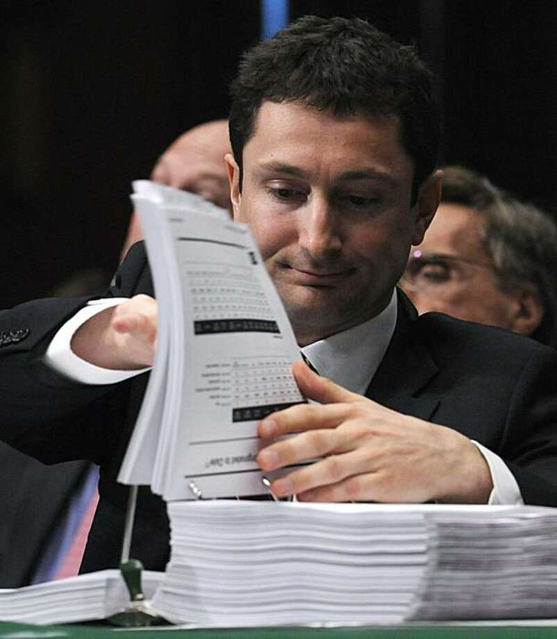 Fabrice Tourre, executive director of the Structured Products Group Trading at The Goldman Sachs Group, Inc, turns the pages of the committee exhibits book as he testified on Capitol Hill in Washington, Tuesday, April 27, 2010, before the Senate Investigations subcommittee. Photo: Susan Walsh, AP