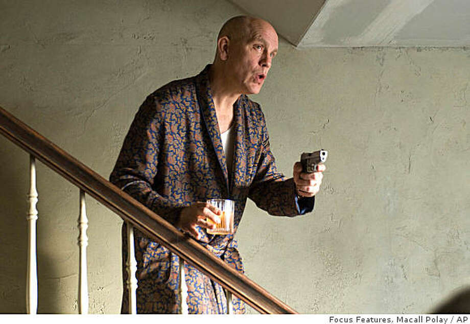 "In this image released by Focus Features, John Malkovich is shown in a scene from, ""Burn After Reading."" Photo: Macall Polay,, Focus Features"
