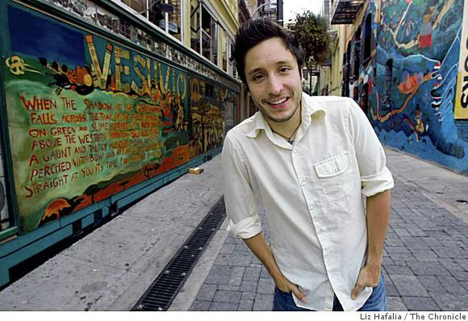 "Filmmaker Art Perez on Jack Kerouac Alley in San Francisco, Calif., on Friday, October 3, 2008, where he was inspired to do ""Where Have All the Flowers Gone,""  a personal documentary that calls for young people to get politically active. Photo: Liz Hafalia, The Chronicle"