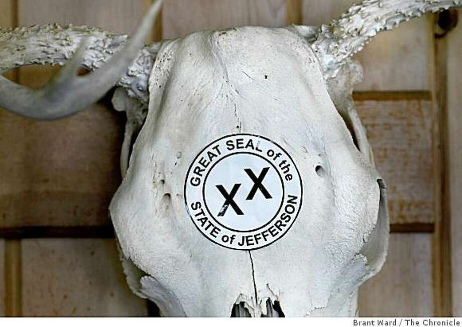 At the local barber shop, a deer skull now wears a Jefferson sticker. In the city of Yreka, Calif. there are visual reminders of some citizens' wish to secede from the union and form their own state of Jefferson. Photo: Brant Ward, The Chronicle