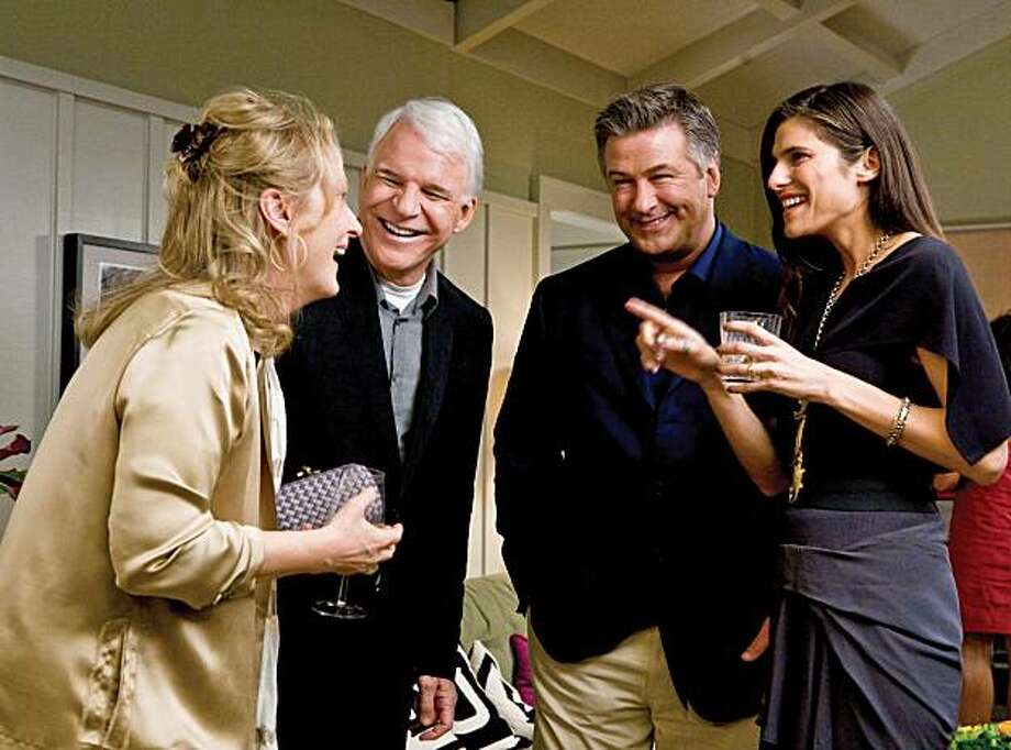 "(Left to right) Jane (Meryl Streep), Adam (Steve Martin), Jake (Alec Baldwin) and Agness (Lake Bell) share a scene in the comedy ""It's Complicated."" (MCT) Photo: Handout, MCT"