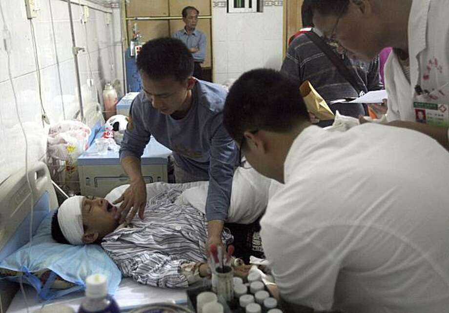In this photo taken Wednesday April 28, 2010, a child who sustained a head injury after a man attacked a primary school recuperates at a hospital in Leizhou city in south China's Guangdong province.  On Wednesday, a man broke into a primary school in Guangdong province's Leizhou city in southern China and wounded 15 students and a teacher with a knife. Photo: Nicky Zhang, AP
