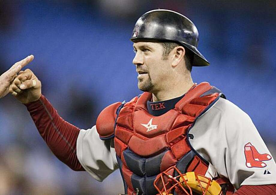 Boston Red Sox catcher Jason Varitek is congratulated by teammates after defeating the Toronto Blue Jays 13-12 in a baseball game in Toronto on Monday April 26, 2009. Photo: Frank Gunn, AP