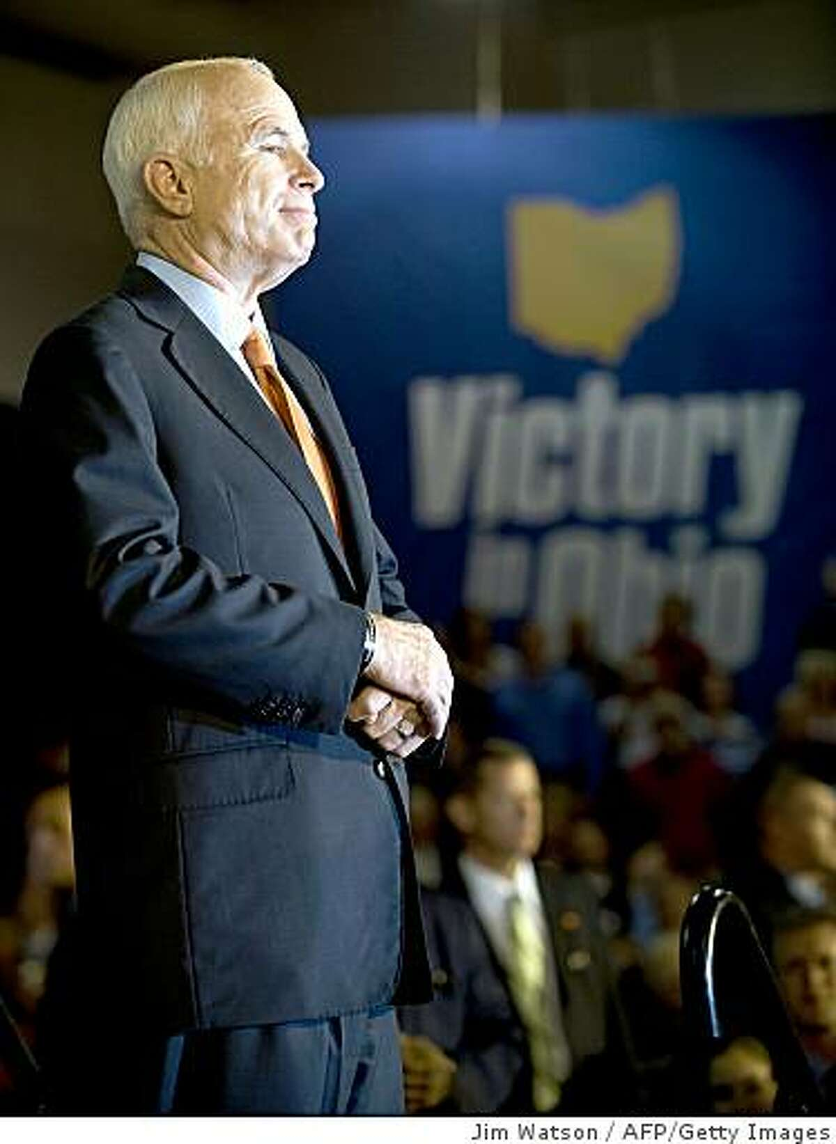 Presidential candidate John McCain listens during a rally at Lehigh University in Bethlehem, Pa., on Oct. 8, 2008.