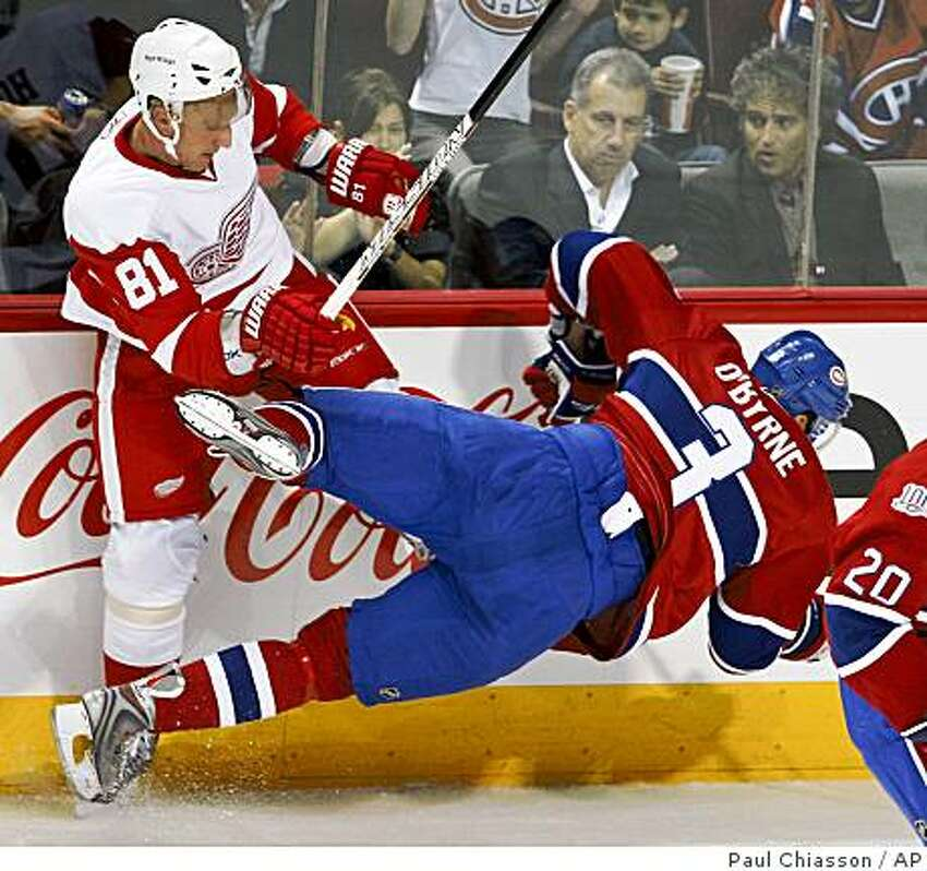 Montreal Canadiens' Ryan O'Byrne, right, is checked by Detroit Red Wings' Marian Hossa during the first period of an NHL preseason hockey game, Tuesday, Sept. 30, 2008 in Montreal. (AP Photo/The Canadian Press, Paul Chiasson)