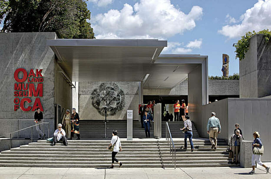 The front entrance off Oak Street  into the newly restored Oakland Museum of California on Thursday Apr. 29, 2010, in Oakland, Calif. In an age of architectural excess, Kevin Roche's once-lauded Oakland Museum looks more revolutionary than ever -- a low assemblage of galleries cloaked with greenery and burrowed into the ground. A new restoration by local architect brings out the compelling potential of the building --- even as its cold concrete nature remains a reminder that modern architectural theory often looked better on paper than real life. Photo: Michael Macor, The Chronicle