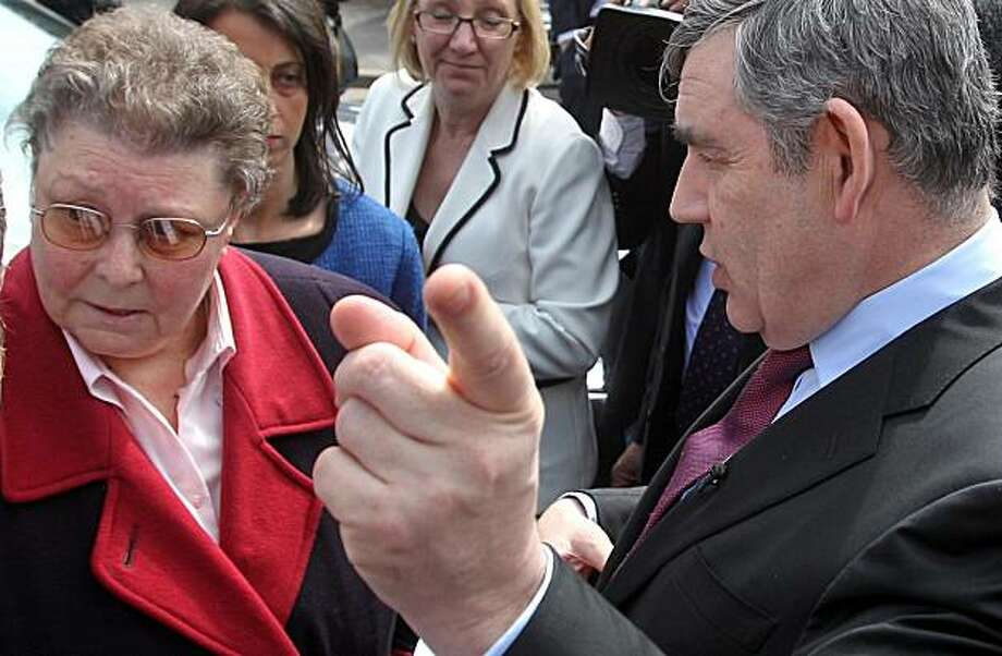 "Britain's Prime Minister Gordon Brown, wearing a Sky News microphone, speaks to local resident Gillian Duffy, 65, while campaigning for Britain's May 6 General Election in Rochdale, England, Wednesday April 28, 2010. Brown was caught on microphone describing a voter he had just spoken to - apparently Duffy - as a ""bigoted woman"". The comments were made as he got into his car, not realising that he had the microphone pinned to his jacket. He told an aide: ""That was a disaster - they should never have put me with that woman. Whose idea was that? It's just ridiculous..."" Asked what she had said, he replied: ""Everything, she was just a bigoted woman."" Photo: Lewis Whyld, AP"