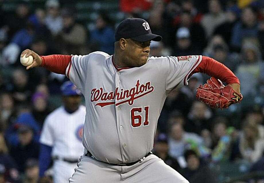 Washington Nationals starting pitcher Livan Hernandez delivers during the first inning of a baseball game against the Chicago Cubs Tuesday, April 27, 2010 at Wrigley Field in Chicago. Photo: Charles Rex Arbogast, AP