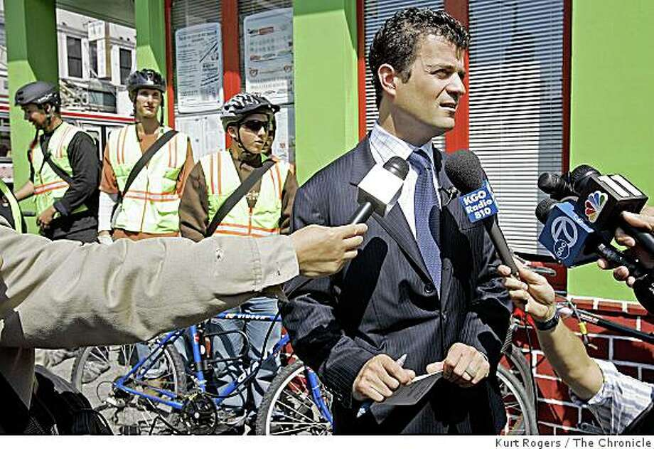 Jared Blumenfeld Director of SF Environment talks to the media as bike messangers in the backgroundstart to head out for a day of mosquito abatement.A day after SF identifies its first-ever case of West Nile virus, a fleet of bike messengers is being dispatched to catch basins throughout San Francisco equipped with Nextel phones with GPS satellite capabilities along with non-toxic abatement pellets that prevent mosquitoes from maturing. It's an alternative to spraying. Agency coordinating it is the Dept. of Environment.WESTNILE_0042_kr.JPG 8/16/05 in San Francisco,CA. Photo: Kurt Rogers, The Chronicle