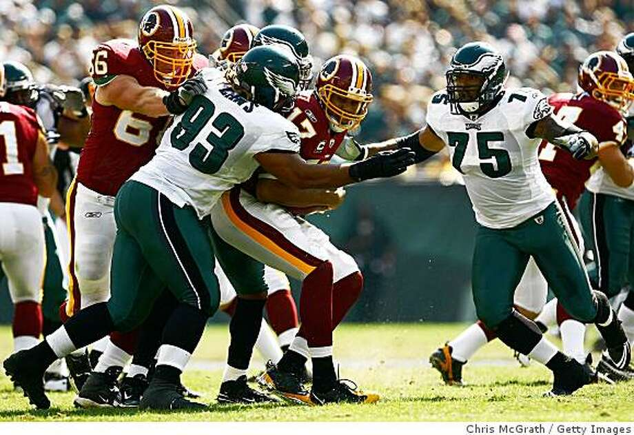 PHILADELPHIA - OCTOBER 05:  Jason Campbell #17 of the Washington Redskins is sacked by Trevor Laws #93, Brian Dawkins #20 and Juqua Parker #75 of the Philadelphia Eagles on October 5, 2008 at Lincoln Financial Field in Philadelphia, Pennsylvania.  (Photo by Chris McGrath/Getty Images) Photo: Chris McGrath, Getty Images