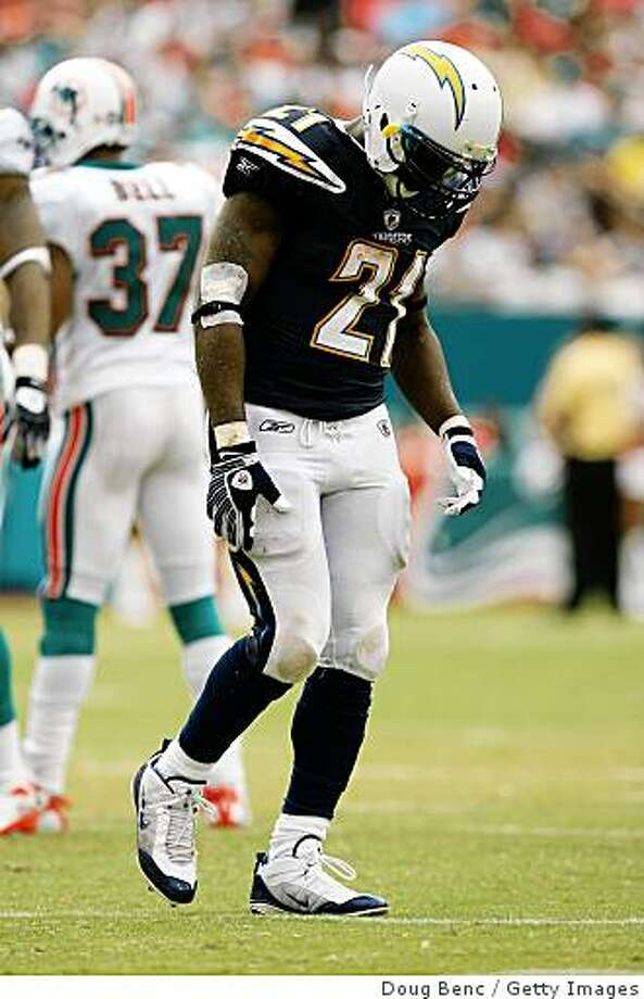 LaDainian Tomlinson limps off the field at Dolphin Stadium on October 5, 2008 in Miami, Florida. The Dolphins defeated the Chargers 17-10. Photo: Getty Images