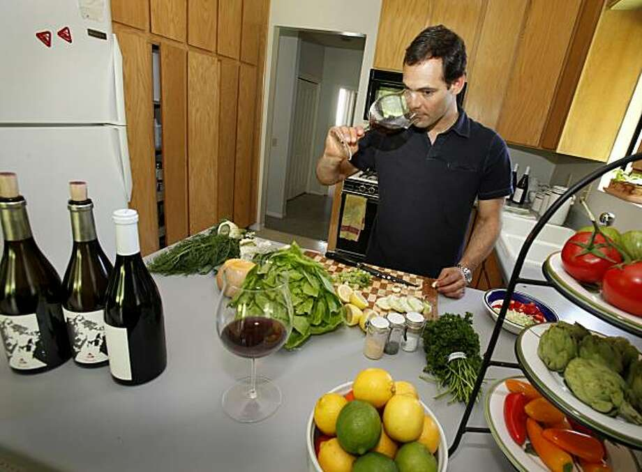 Jon Grant is the winemaker at Couloir in Napa Valley, Calif.  He combines his 2007 Pinot Noir from Anderson Valley with a mire poix risotto he is preparing at his St. Helena, Calif. home. Photo: Brant Ward, The Chronicle