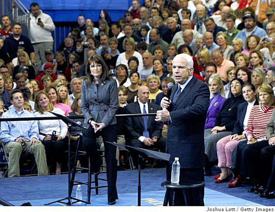WAUKESHA, WI - OCTOBER 9:  Republican presidential candidate Sen. John McCain (R-AZ) (R) speaks as Republican vice-presidential candidate Alaska Gov. Sarah Palin listens during a town hall meeting at the Center Court Sports Complex, October 9, 2008 in Waukesha, Wisconsin. McCain and Palin spoke  about off-shore drilling and making the economy stronger. (Photo by Joshua Lott/Getty Images) Photo: Joshua Lott, Getty Images